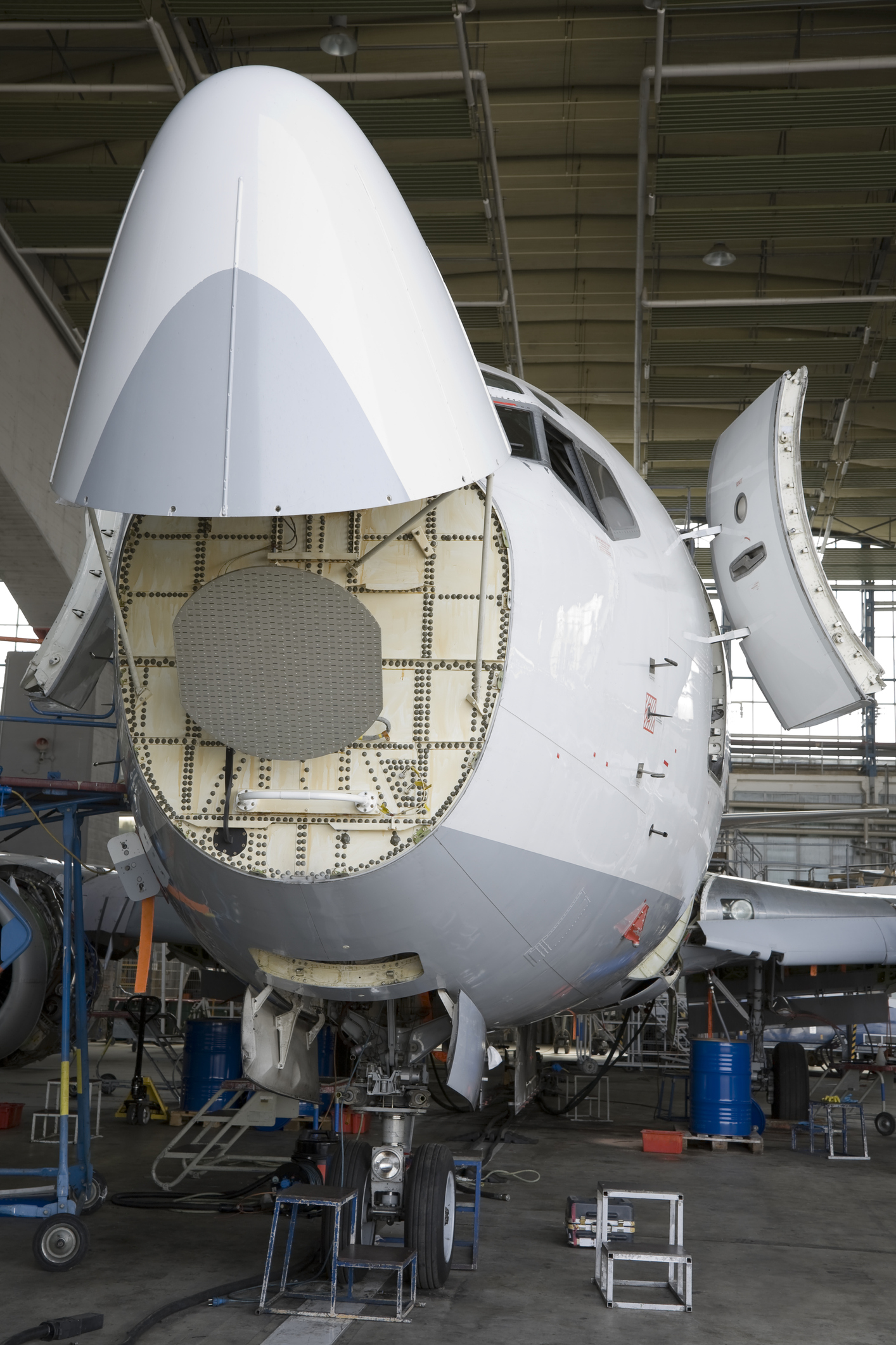 Commercial Airplane Maintenance Check in Hangar